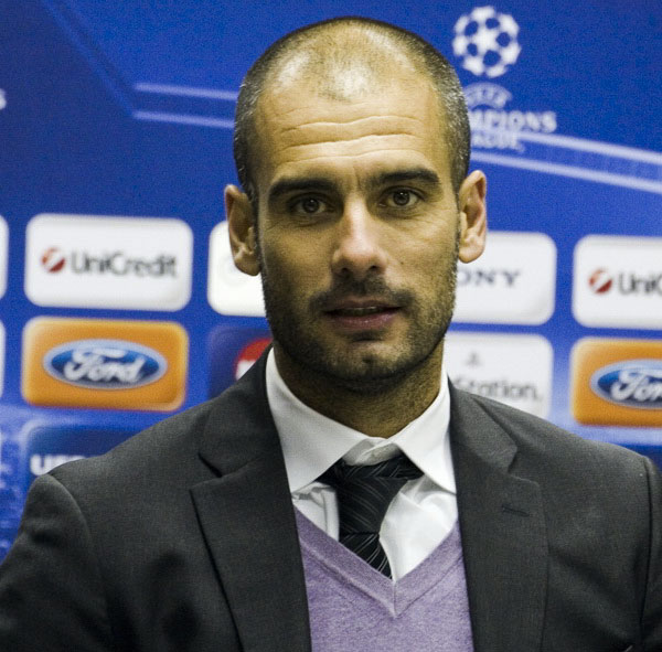 Josep Guardiola with a buzz cut resembling Gerard Pique