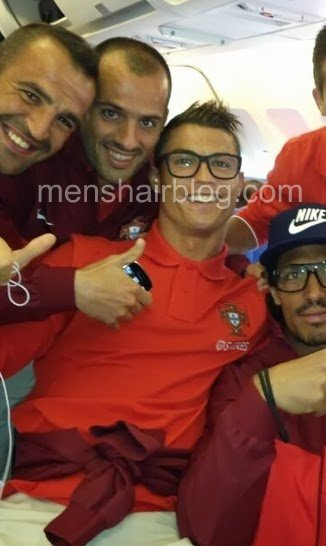 Cristiano Ronaldo on an airplane with Portugal and sporting an undercut hairstyle with a quiff.