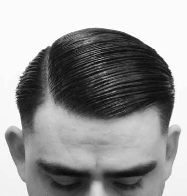 A side swept hairstyle by a male with pomade