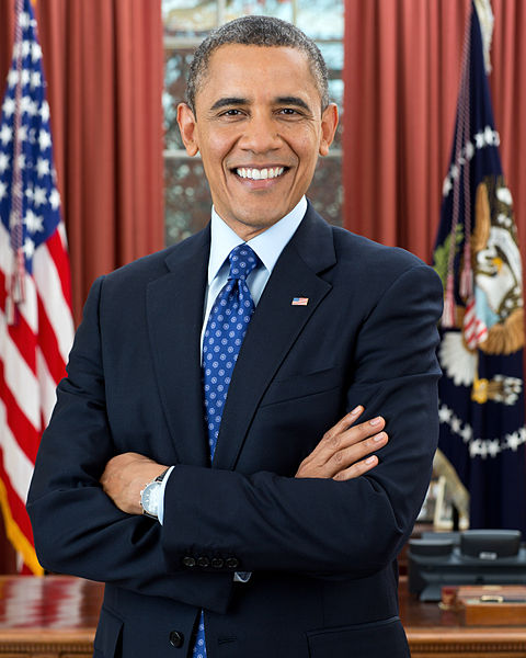 Barack Obama with his kinky curly hair in a crew cut hairstyle