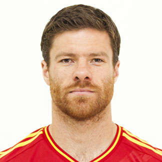 The Ivy League haircut of Xavi Alonso with a side part