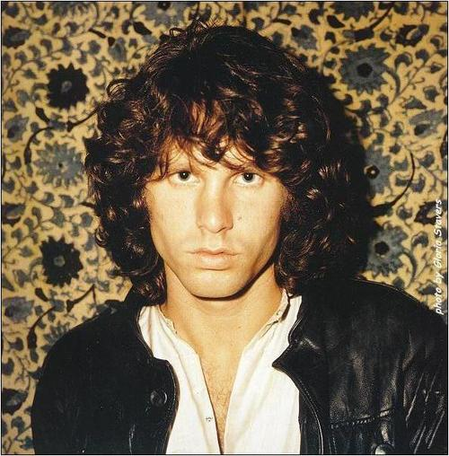Jim Morrison with his classic long hair style